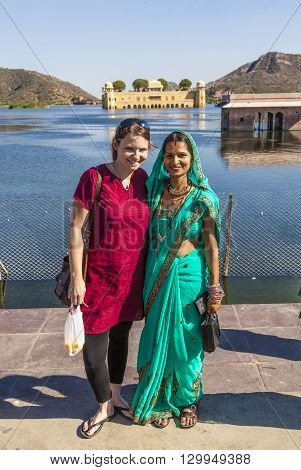 Portrait Of Indian And Western Girl In Colorful Ethnic Attire At Sagar Lake In Jaipur