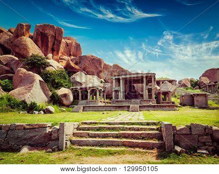 Vintage retro effect filtered hipster style image of tourist indian landmark Ancient ruins in Hampi. Hampi Bazaar, Hampi, Karnataka, India