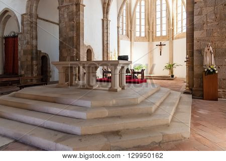 Santarem, Portugal. September 11, 2015: Altar and Apse of the Santa Clara Church. 13th century Mendicant Gothic Architecture.