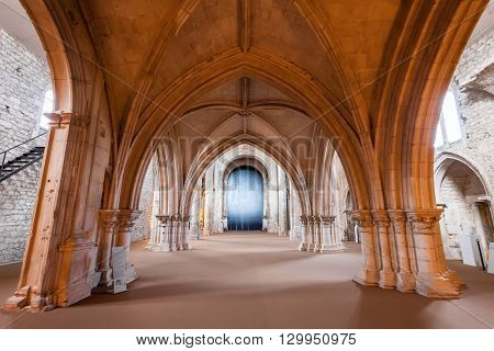 Santarem, Portugal. September 11, 2015: View under the High-Choir porch in the Church of the Sao Francisco Convent. 13th century Mendicant Gothic Architecture. Franciscan Religious Order.