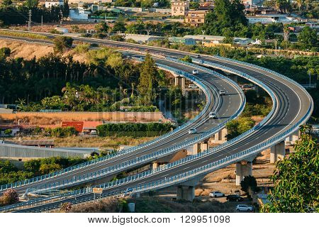 Motion Cars On Freeway Near Fuengirola In Spain, Europe. Sunset Sunrise Time