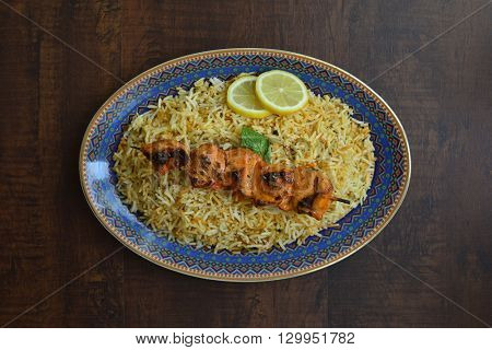 Biryani rice with chicken barbecue. Popular asian food.
