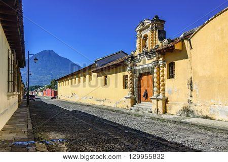 Agua volcano & typical cobblestone street in colonial city & UNESCO World Heritage Site of Antigua.