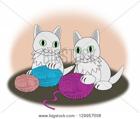 Two kittens playing with colorful balls of yarn.