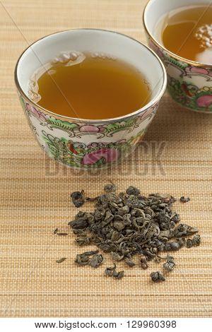 Two cups with green gunpowder tea