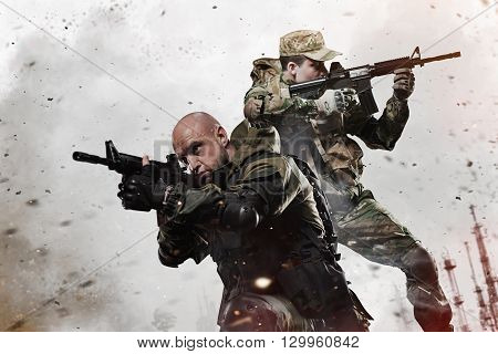 Military war conflict soldiers - Two Special forces soldiers men take aim on machine gun