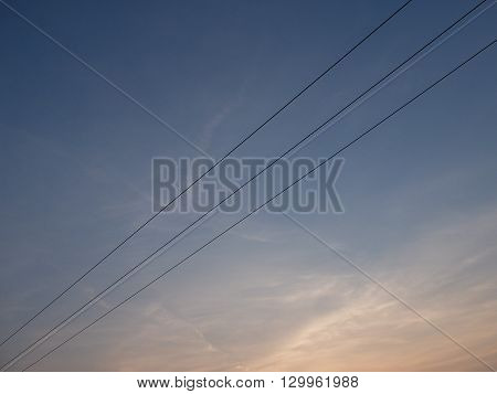 Triple power cables and sunset blue sky