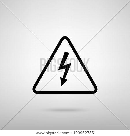 High voltage danger sign. Black with shadow on gray.