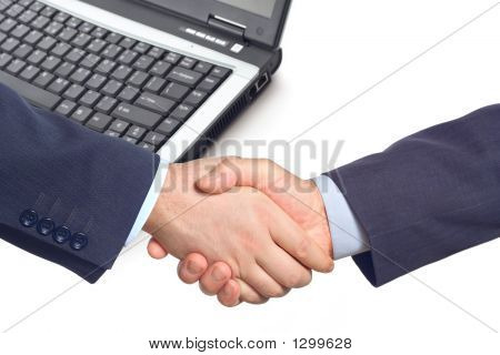 Business Handshake  With A Laptop