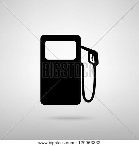 Gas pump sign. Black with shadow on gray.