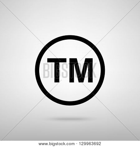 Trade mark sign. Black with shadow on gray.