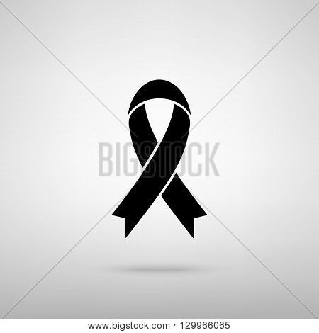 Black awareness ribbon sign. Black with shadow on gray.