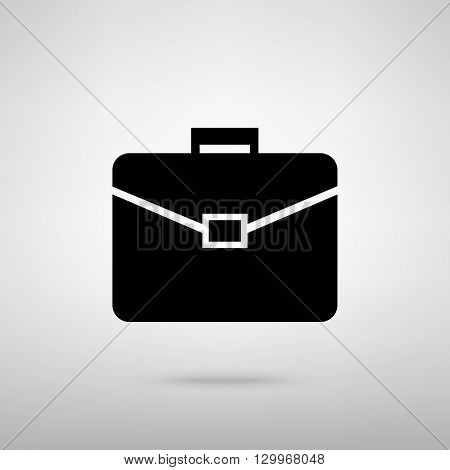 Briefcase sign. Black with shadow on gray.