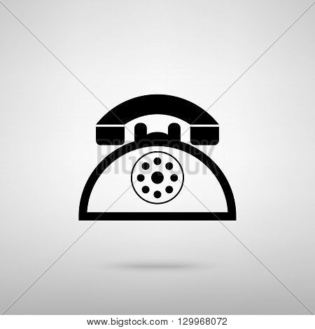 Retro telephone sign. Black with shadow on gray.