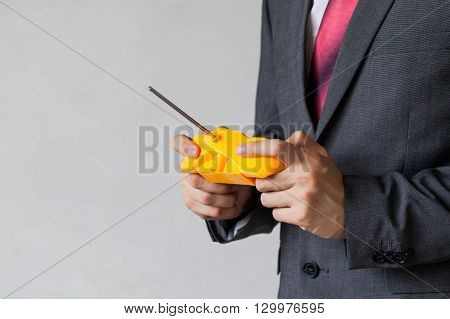 Business Man Holding A Joystick - Manipulation, Controlling, Entertainment Concept