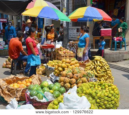 QUETZALTENANGO GUATEMALA april 28 2016 : People sale fruits in Quetzaltenango maket. This native market is the most colorful in Central America