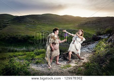Caveman Couple In Love At Mountains