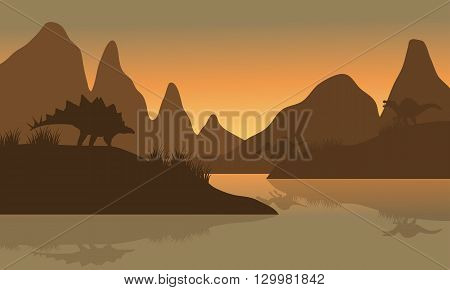 Silhouette of spinosaurus and stegosaurus in riverbank