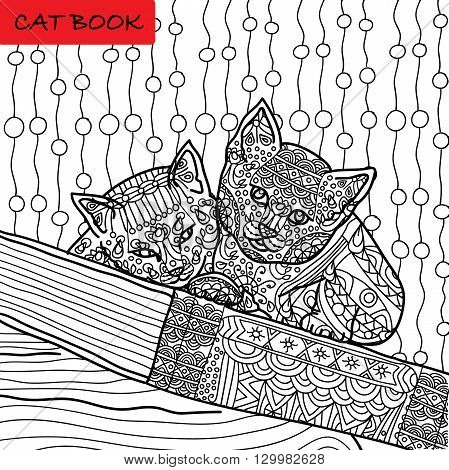 Coloring cat page for adults. Two funny kitten sitting on book. Hand drawn illustration with patterns. Zenart