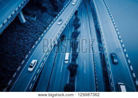 aerial view of traffic on chongqing overpass,china,blue toned image.