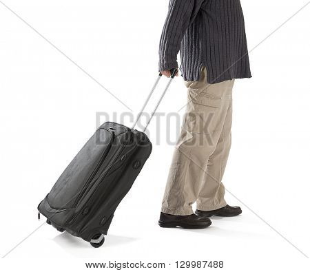 Traveler with a black travel bag isolated on white background.