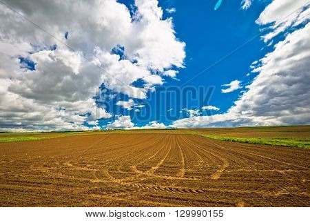 Plowed field under dramatic sky view agricultural region of Prigorje Croatia