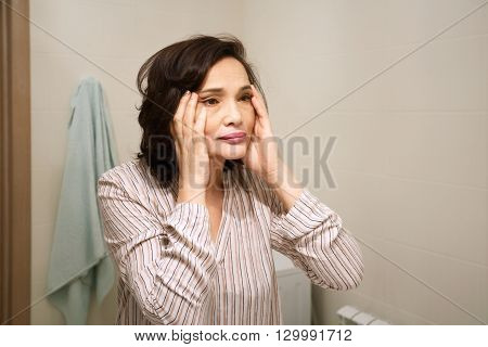 Portrait Of Middle-aged Woman's Reflection. Beautiful Brunette Elderly Female Wearing Pajamas, A