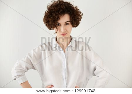 Portrait Of Young Caucasian Businesswoman With Short Dark Hair, Wearing Casual Clothes, Looking In A