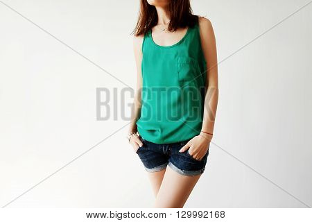 Cropped Isolated Shot Of Young Casual Woman Posing With Hands In Pockets. Happy Female Teenager Enjo