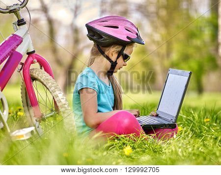 Bikes cycling girl. Girl rides bicycle. Girl in cycling sitting near bicycle and watch pc tablet. Cycling is good for health. Cyclist looking for road. Outdoor recreation with pc tablet.