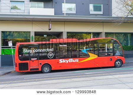 Melbourne, Australia - May 1, 2016: SkyBus waiting for departure outside a hotel in Melbourne. SkyBus has provided  transfer service from Melbourne Airport to the city centre for over 35 years.