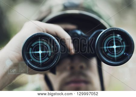 hunting, war, army and people concept - close up of young soldier, ranger or hunter with binocular and virtual projection observing forest