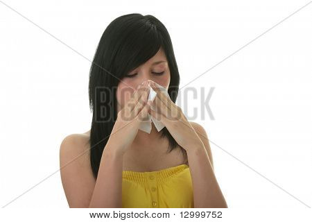 Young woman with allergy or cold holding handkerchief, isolated on white background