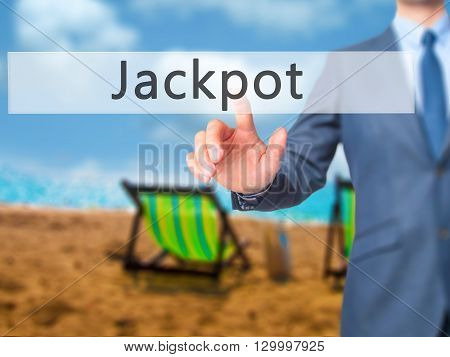 Jackpot - Businessman Hand Pressing Button On Touch Screen Interface.