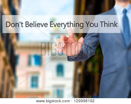 Don't Believe Everything You Think - Businessman Hand Pressing Button On Touch Screen Interface.