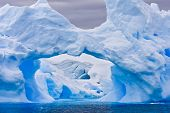 image of hollow log  - Large Antarctic iceberg with a cavity inside - JPG