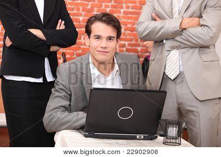 Smart young man at a laptop computer