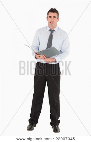 Businessman holding a binder against a white background