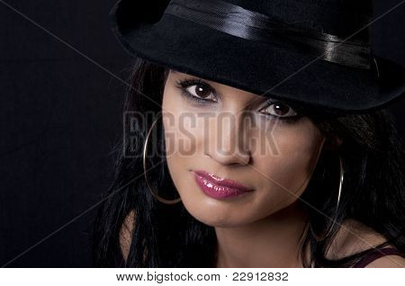 Beautiful Brunette With Black Hat