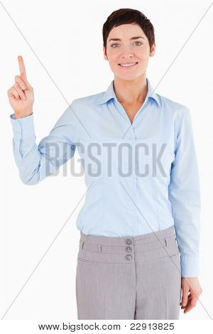 Portrait of a businesswoman pointing at copy space while looking at the camera
