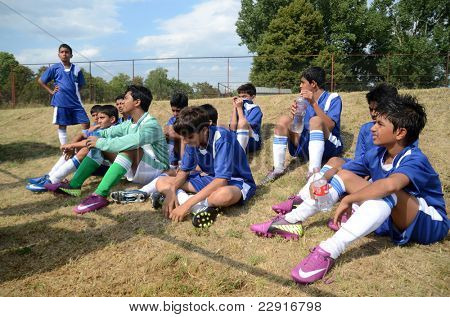 KAPOSVAR, HUNGARY - JULY 18: Unidentified Indian players listen to trainer at the VII. Youth Football Festival match Navrachana Ac. (blue) (IND) vs. Rakoczi FC (green) (HUN) on July 18, 2011 in Kaposvar, Hungary