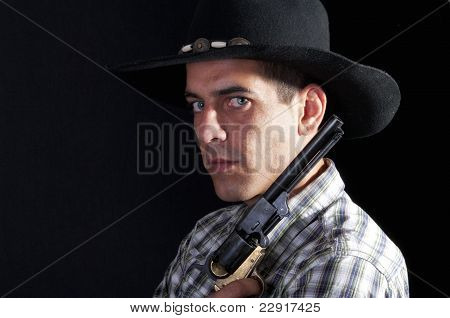 Cowboy With Hat And Revolver