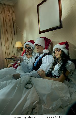 Manager with two his subordinates watching tv on New Year's night