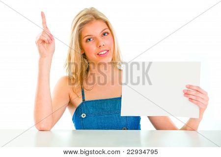 Teen Girl With Rised Finger Holding Blank Paper