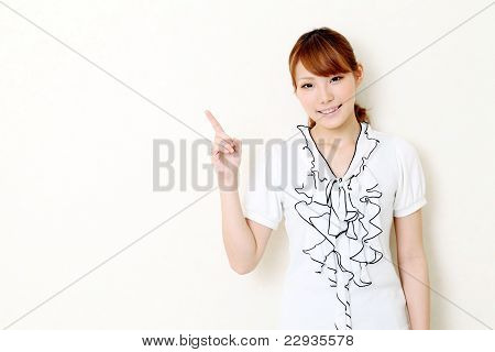 young japanese businesswoman pointing