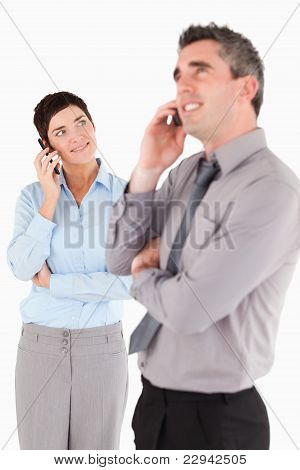 Portrait Of Office Workers Making A Phone Call
