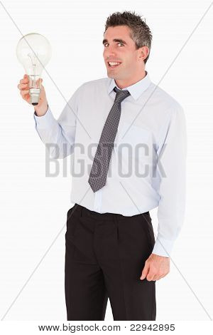 Smiling Man Holding A Light Bulb