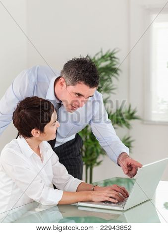 Portrait Of A Manager Pointing At Something To His Secretary On