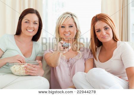 Charming Women Watching A Movie Eating Popcorn