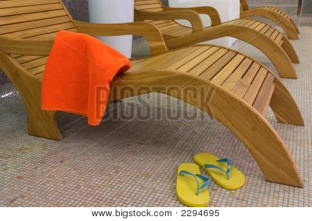 Sunbed With Orange Towel And Sandals